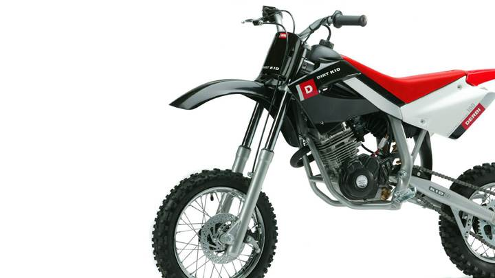 Derbi Dirt Kid 100 In Red And White Side Pose And White Bsckground